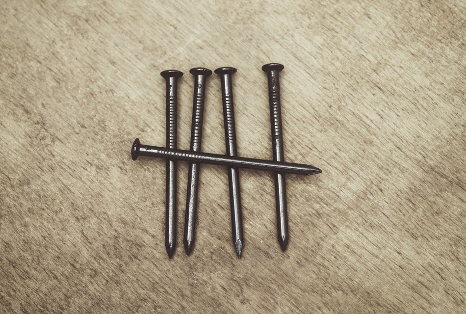tally marks made with nails Arrangement Close-up Composition Counting Directly Above Five Group Indoors  Marks Metal Metallic Nail Nails No People Objects Still Life Symbol Symbolism Tally Marks