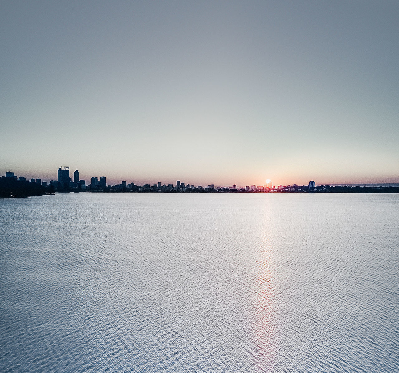 sunset, water, waterfront, architecture, built structure, outdoors, building exterior, sky, city, clear sky, skyscraper, nature, no people, cityscape, river, beauty in nature, sun, tranquility, scenics, urban skyline, day