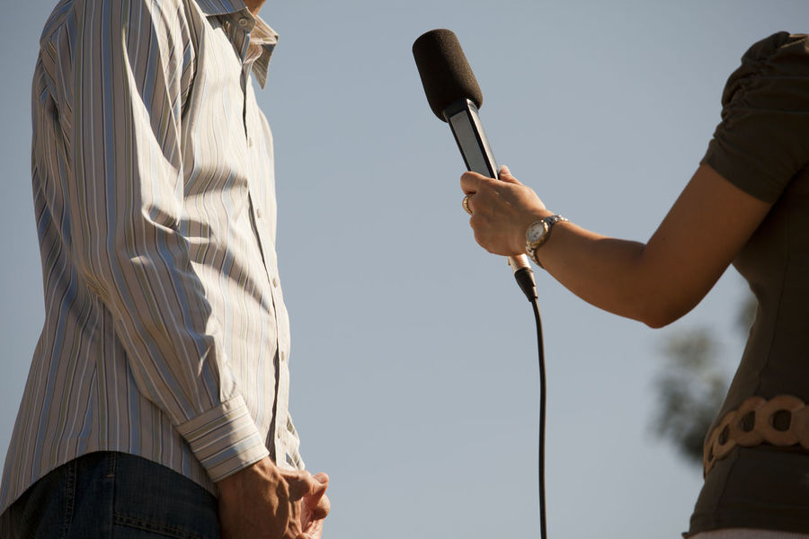 Journalist. Media interview. Journalism. Journalist Mic Press Unrecognizable People Working Answering Answering Questions Broadcasting Journalism Communication Holding Human Hand Information Journalism Media Media Interview Microphone News Occupation Outdoors People Question Reporter Unrecognizable Person
