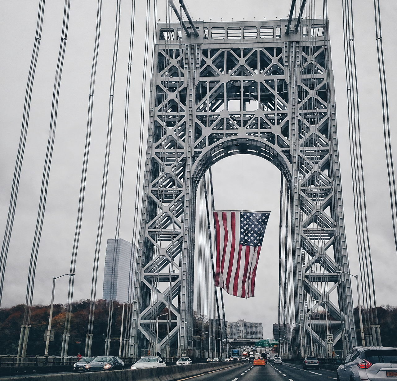 patriotism, flag, built structure, stars and stripes, transportation, day, architecture, outdoors, low angle view, no people, sky