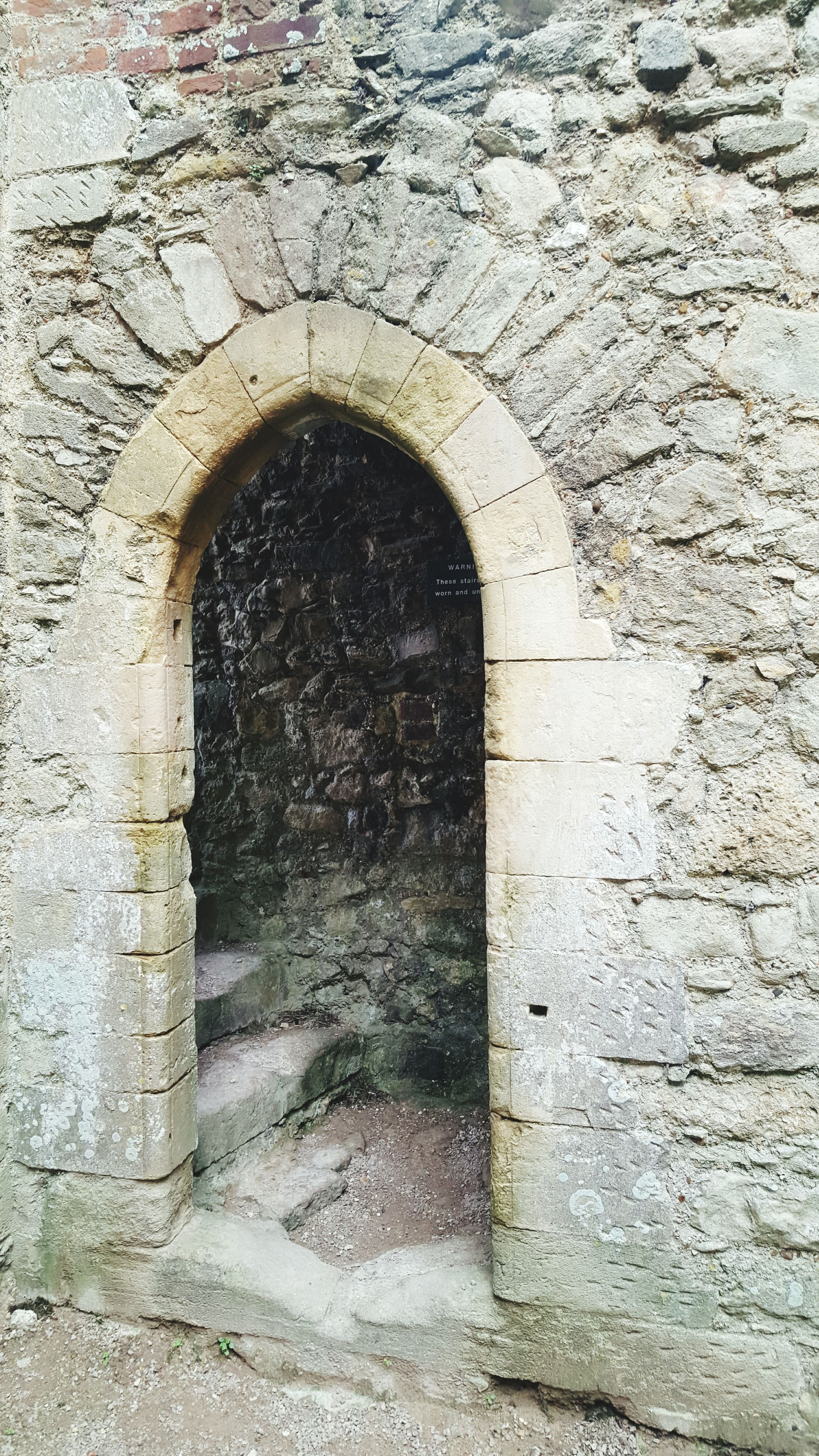 arch, architecture, built structure, wall - building feature, brick wall, stone wall, building exterior, circle, tunnel, old, day, weathered, hole, archway, wall, street, outdoors, textured, no people, cobblestone