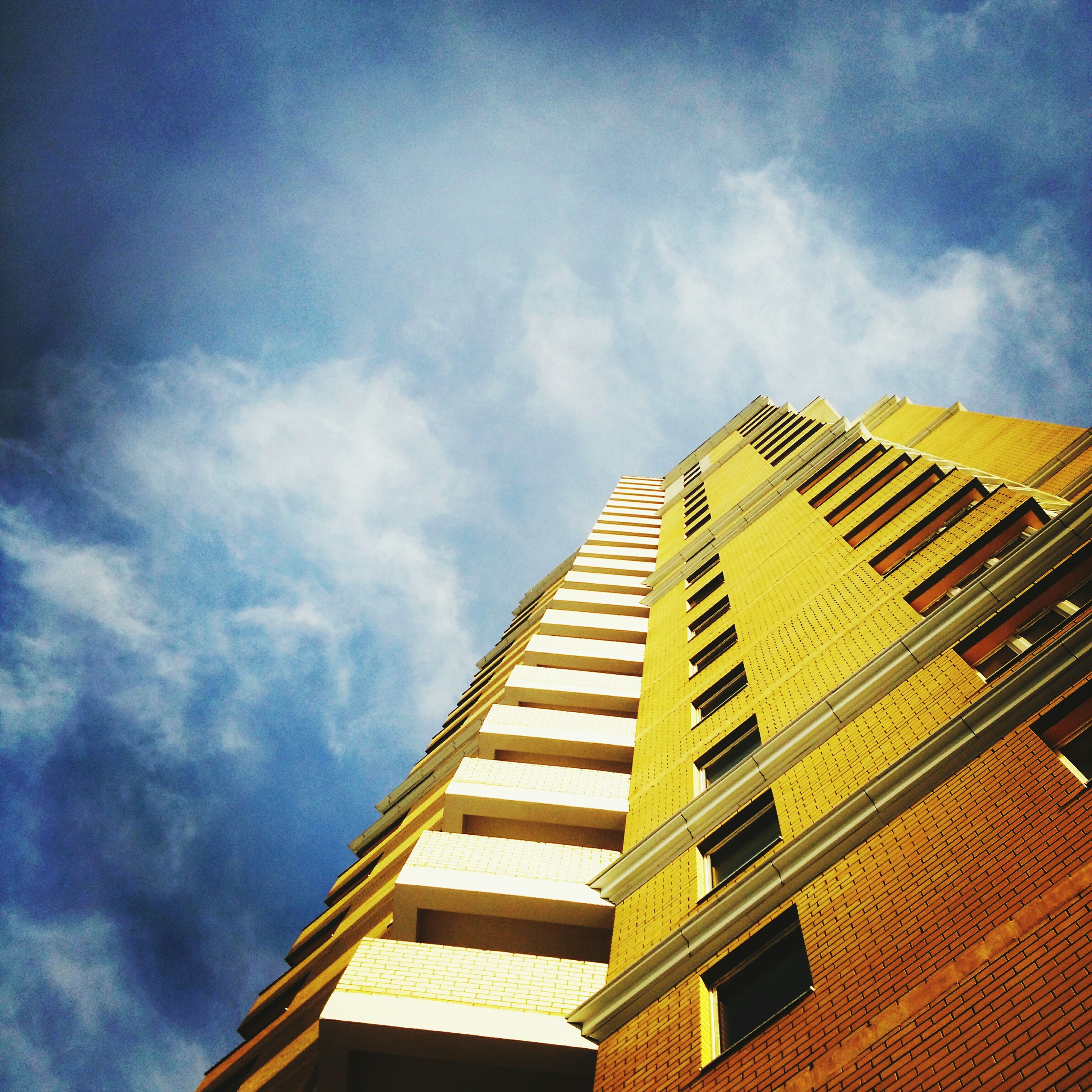 sky, low angle view, architecture, building exterior, built structure, cloud - sky, day, no people, outdoors, skyscraper