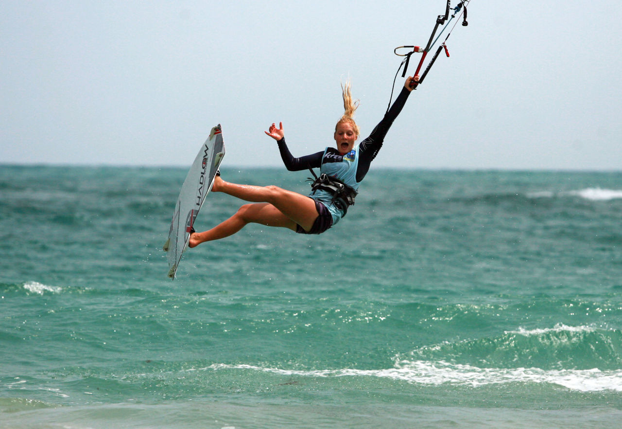 sea, water, one person, real people, mid-air, full length, leisure activity, nature, day, horizon over water, waterfront, outdoors, lifestyles, jumping, sky, beauty in nature, young women, extreme sports, young adult, people