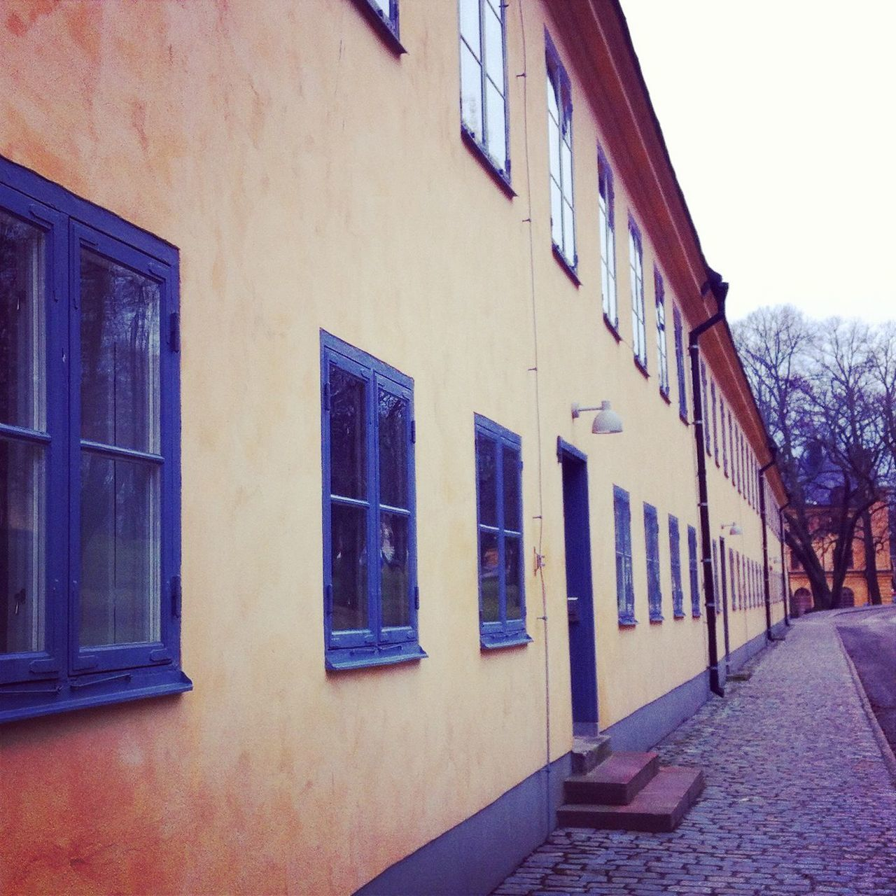 Stockholm Street Architecture Blue Building Building Exterior Built Structure City Day Diminishing Perspective Empty House Narrow No People Outdoors Residential Building Residential Structure Schwedenhaus Sky Stockhom Sweden The Way Forward Yellow