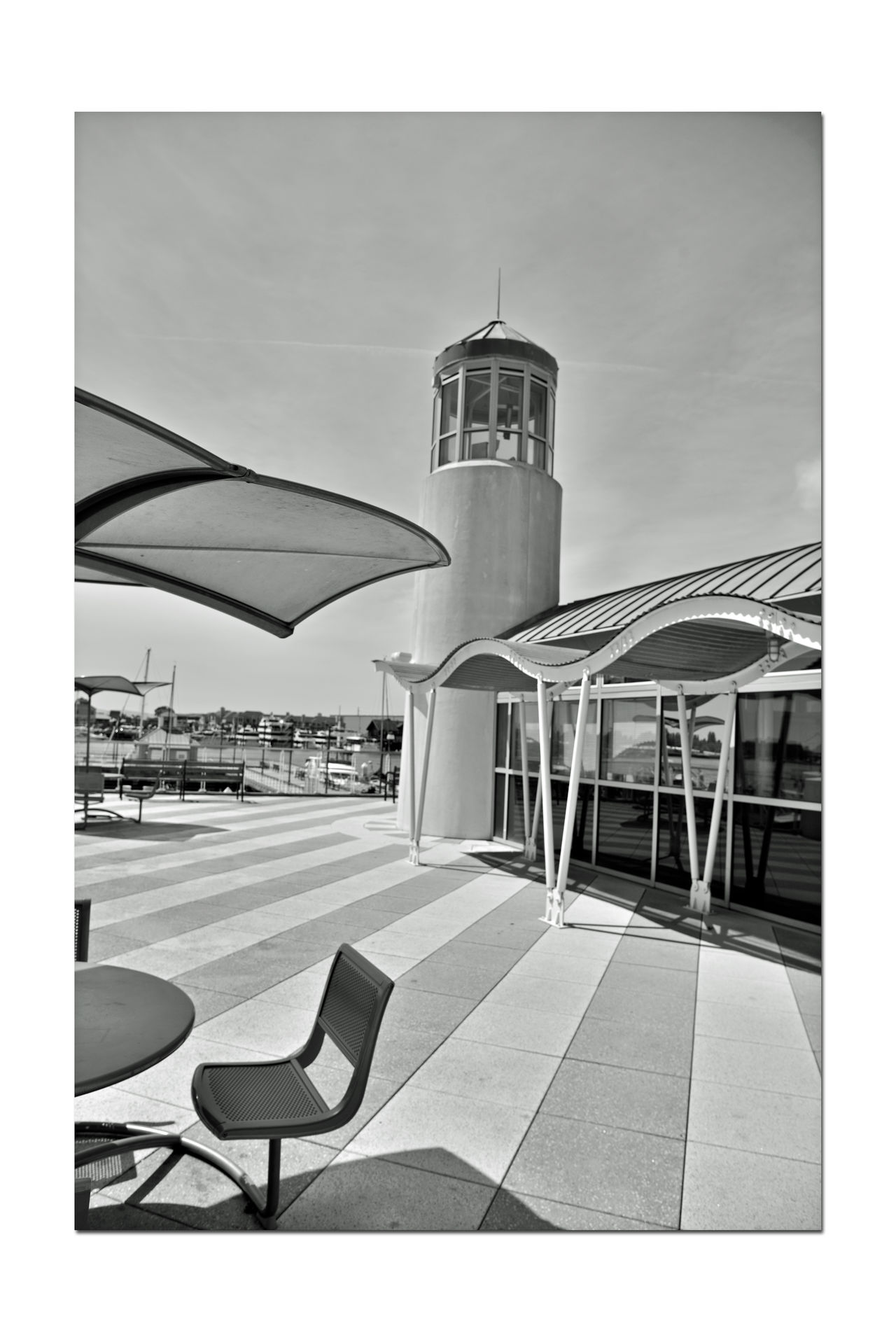 Observation Deck At Jack London Square 2 Embarcadero Cove Port Of Oakland, Ca. Art Is Everywhere Architecture Nautical Theme Architectural Feature Wave-rendered Awning Lookout Lighthouse Tower Ocean-tinted Glass Jack London Square Marina Nautical Fuel Depot Restaurant, Retail & Entertainment District Waterfront Opposite Shore Alameda Marina Monochrome Photograhy Monochrome Black & White Black & White Photography Black And White Collection  Black And White Deck Seating Shadows
