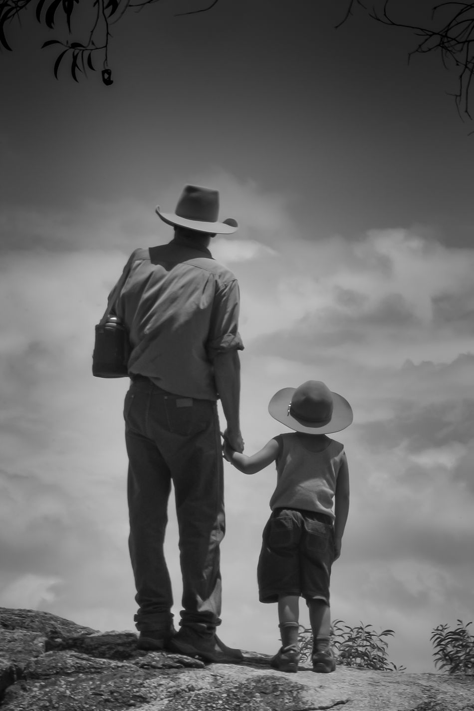 Some wisdom is best handed down personally. Father and son look out into the cloudscape after hiking to a remote ridge top in Far North Queensland. Australia Love Life, Love Photography Blackandwhite Photography Father Father & Son Fatherhood  Photography EyeEmNewHere Man Son Hat Cowboy Hiking Family Queensland Australia Fnq Far North Qld Clouds And Sky Two People Alone In Nature Simple Holding Hands Love Family Time Walking Around Walkabout Hikingadventures Bushwalking
