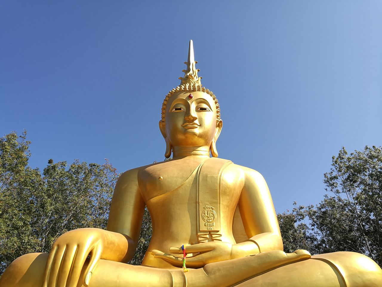 statue, religion, sculpture, male likeness, spirituality, human representation, low angle view, idol, golden color, gold colored, no people, clear sky, sky, day