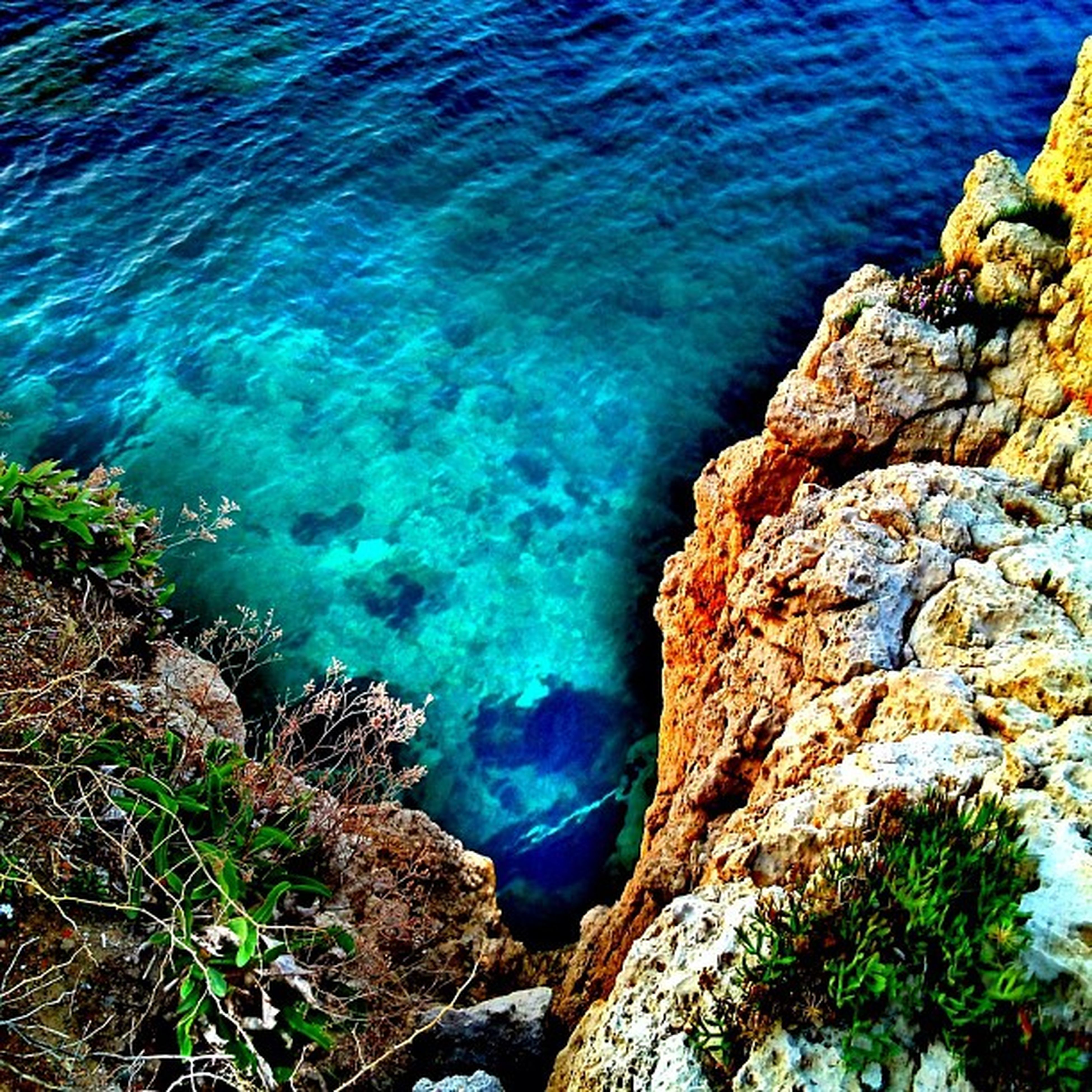water, sea, blue, high angle view, rock - object, tranquility, rock formation, beauty in nature, nature, tranquil scene, scenics, rock, turquoise colored, cliff, day, rippled, idyllic, no people, outdoors, coastline