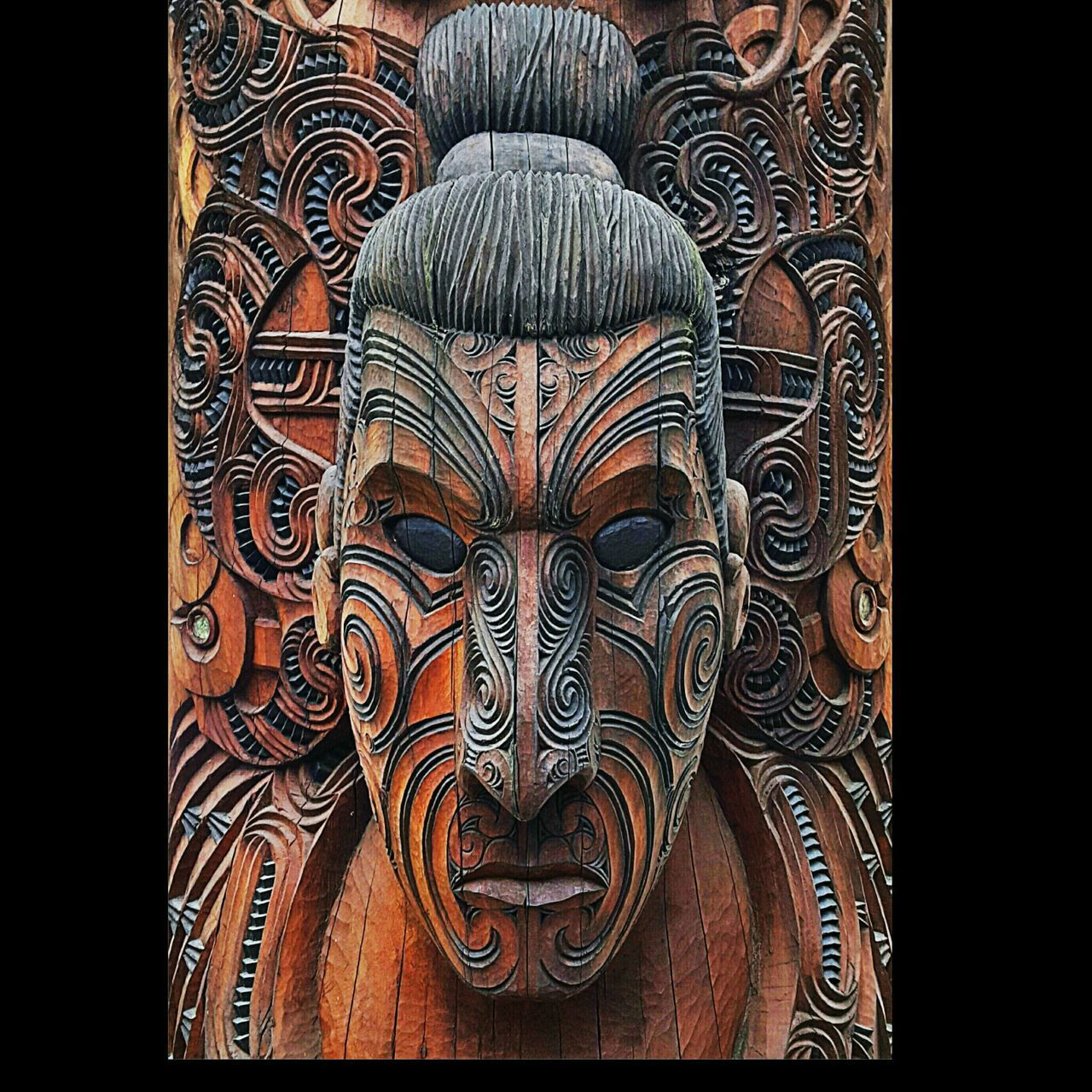 This is one of the 12 carvings at Te Pui Rotorua  Newzealand representing a Moari celestial guardian Travel Visiting Carving Art Tatoo Face Amazing