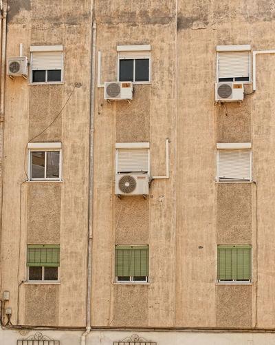 Air Conditioner Architecture Backgrounds Building Building Exterior Façade No People Photographer Arturo Macias Poor Suburban Repetition Residential Building Residential Structure Suburban Suburban Landscape Window