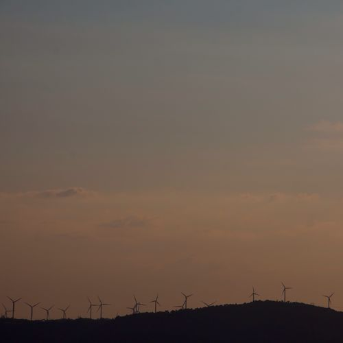What's behind the mountain? Sunset Wind Turbine Summerescape Mediterranean Landscape Behind The Mountains