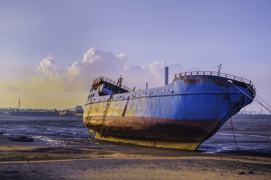 Lonely ship at its Retired age. Beach Composition Evening Landscapes Ship Summer Travel Abandoned Beach Beauty In Nature Cloud - Sky Day Mode Of Transport Moored Nature Nautical Vessel No People Nobody Outdoorphotography #nature #natureporn #naturelove #natureelite #naturelover #sunrise_sunsets_aroundworld #fireinthesky #outdoorlovers #outdoorphotoshoot #nature_brilliance #naturephotography #bestoftheday Outdoors Sand Sea Sky Transportation Water First Eyeem Photo