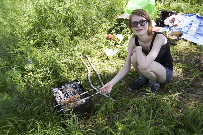 Cooking Glasses Picnic Skewer Brazier Charcoal Day Field Grass Happiness Looking At Camera Meat Nature One Person Outdoors Real People Smiling Young Adult Young Women