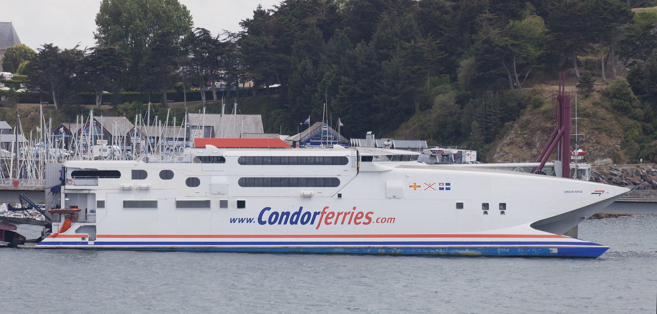 Ferry 'Condor Rapide' of Condor Ferries in the harbor of Saint-Malo, France Catamaran Commercial Ferry Ferryboat France Freight Transportation Guernsey Hydrofoil Industry Mode Of Transport Modern Moored Nautical Vessel Passenger Ship Public Transportation Saint-Malo Sea Ship Shipping  Speed Tall Ship Tourism Transportation Travel Water