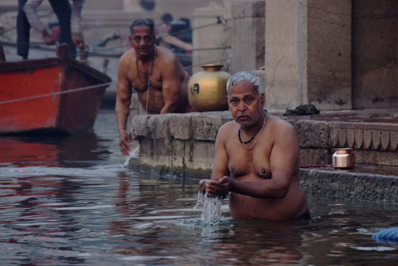 Water Looking At Camera Real People Hindu Varanasi, India Ganges, Indian Lifestyle And Culture, Bathing In The Ganges, Indianphotography Indian India Indian Culture  Hindu Culture Varanasi Hinduism Ganges Bathing In Ganga Ritual Ceremony Hindu Ceremony Bathing Ritual Portrait Cultures Morning Light People