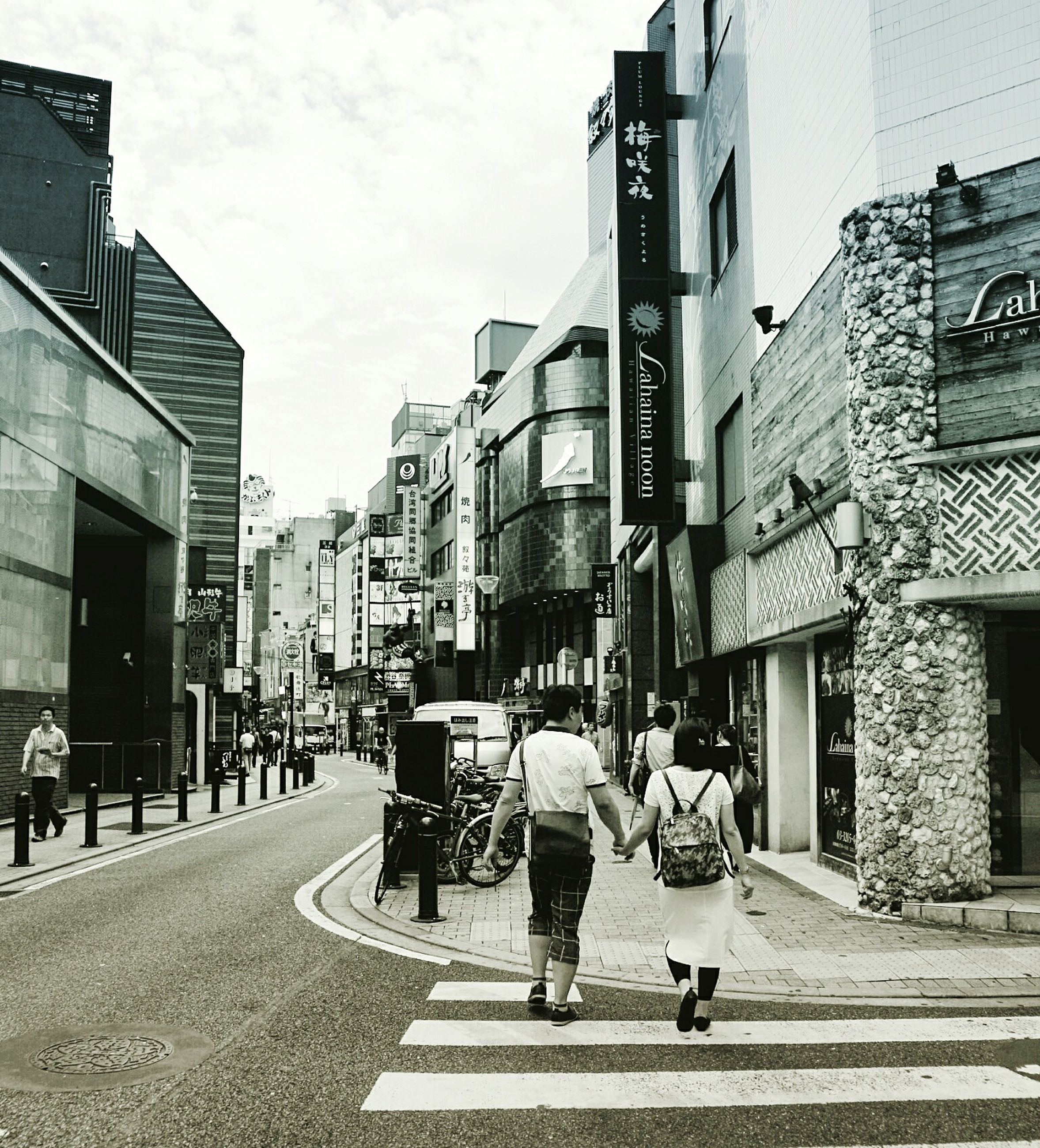 architecture, building exterior, built structure, walking, city, person, men, full length, street, rear view, lifestyles, road, city life, sky, day, casual clothing, group of people, the way forward, outdoors, footpath, tall - high