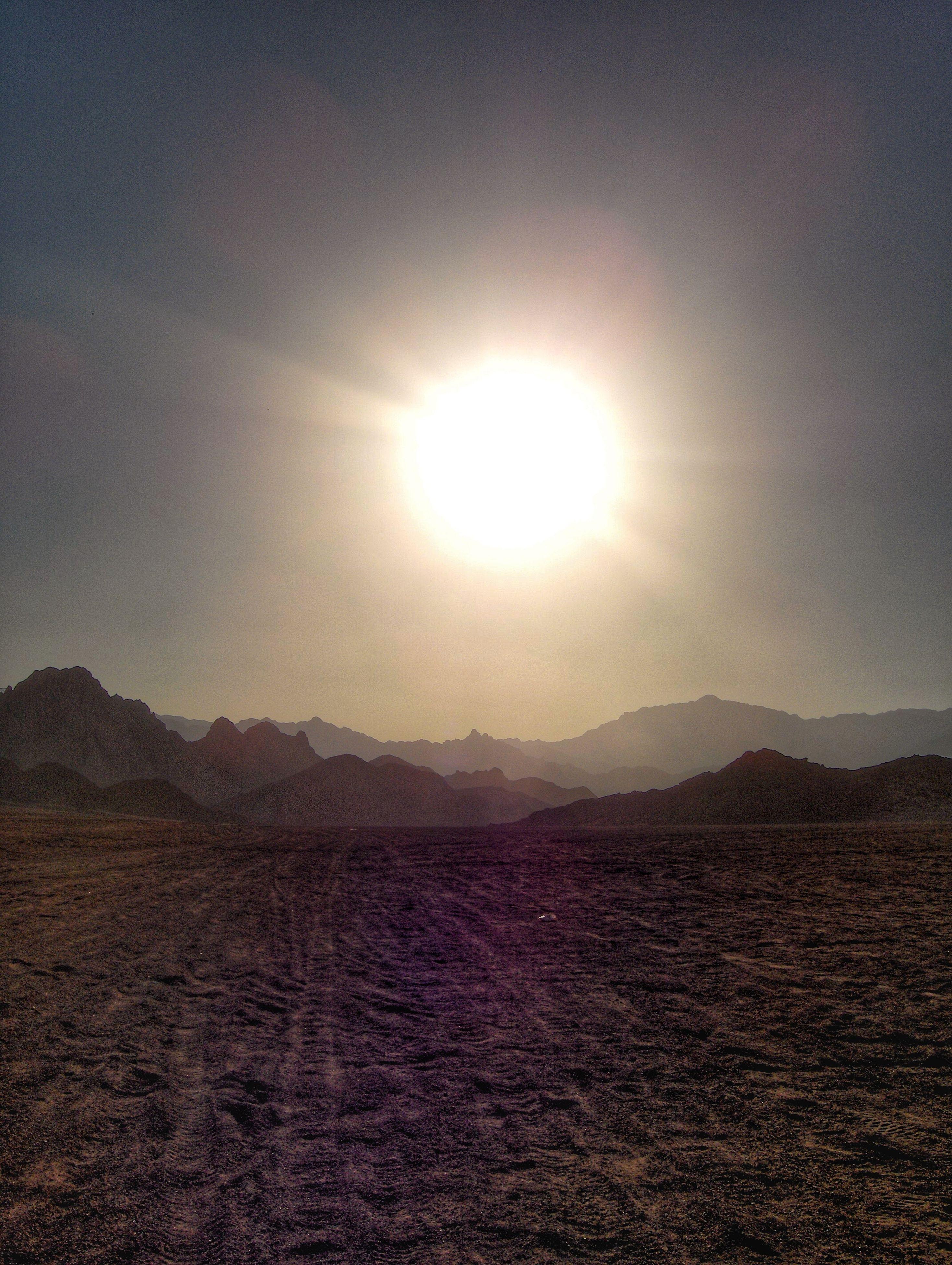 tranquil scene, tranquility, sun, mountain, scenics, beauty in nature, landscape, sky, sunlight, nature, sunbeam, mountain range, non-urban scene, lens flare, idyllic, remote, sand, outdoors, desert, no people