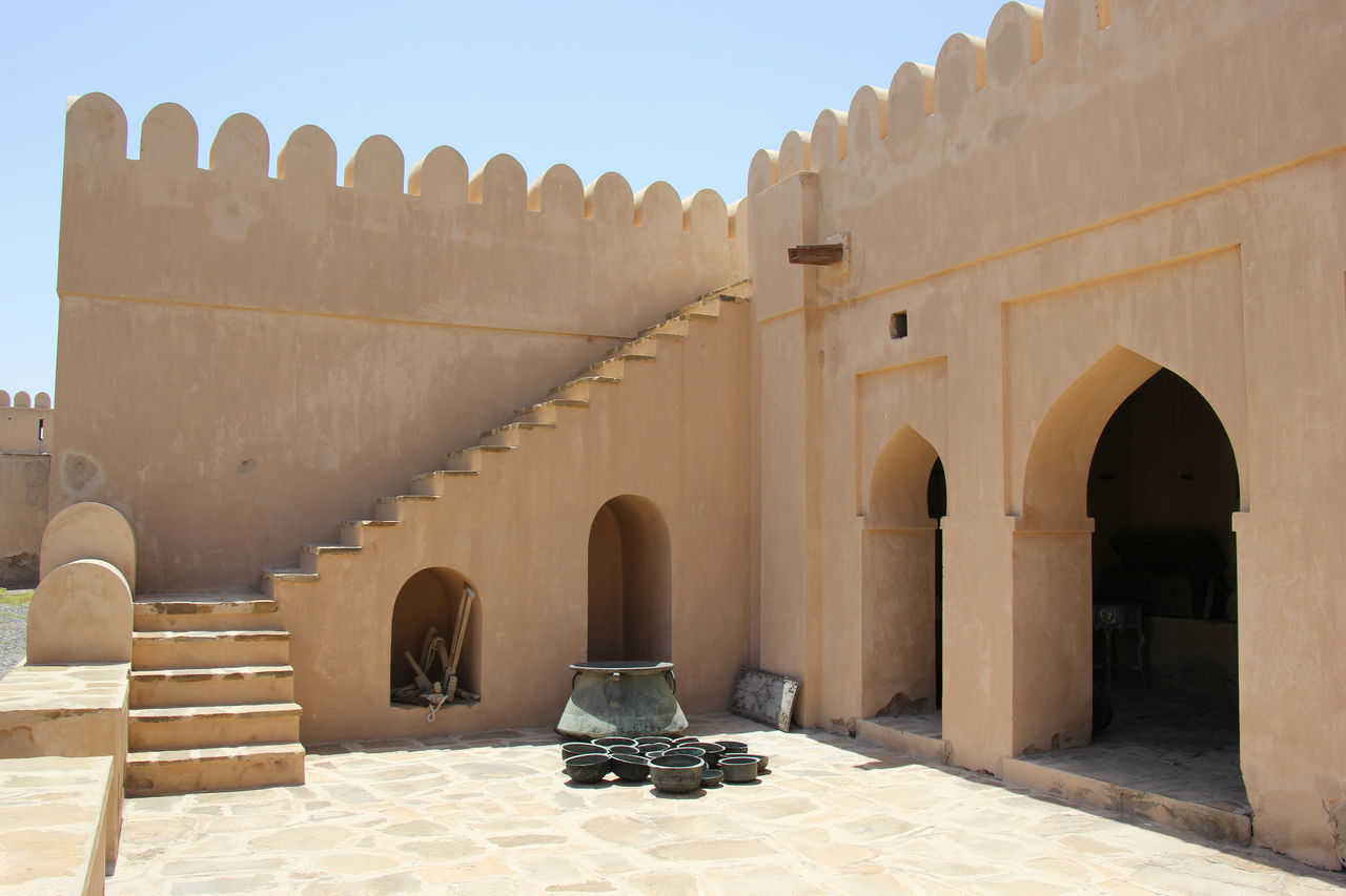 Ancient Ancient Civilization Arabic Architecture Arch Architectural Column Architecture Building Exterior Built Structure Clear Sky Day Fort Fortress History No People Old Ruin Oman Outdoors Place Of Worship Religion Shadow Sky Sunlight The Past Travel Destinations