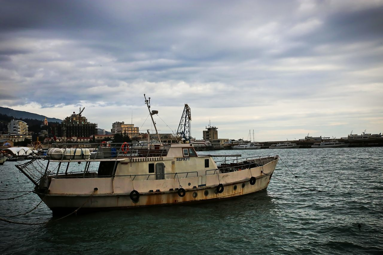 The sea vessel, for fishing costs at pier. Atmospherically, weather gloomy. Cloud - Sky Day Harbor Nature Nautical Vessel No People Outdoors Sky Transportation Traveling Water