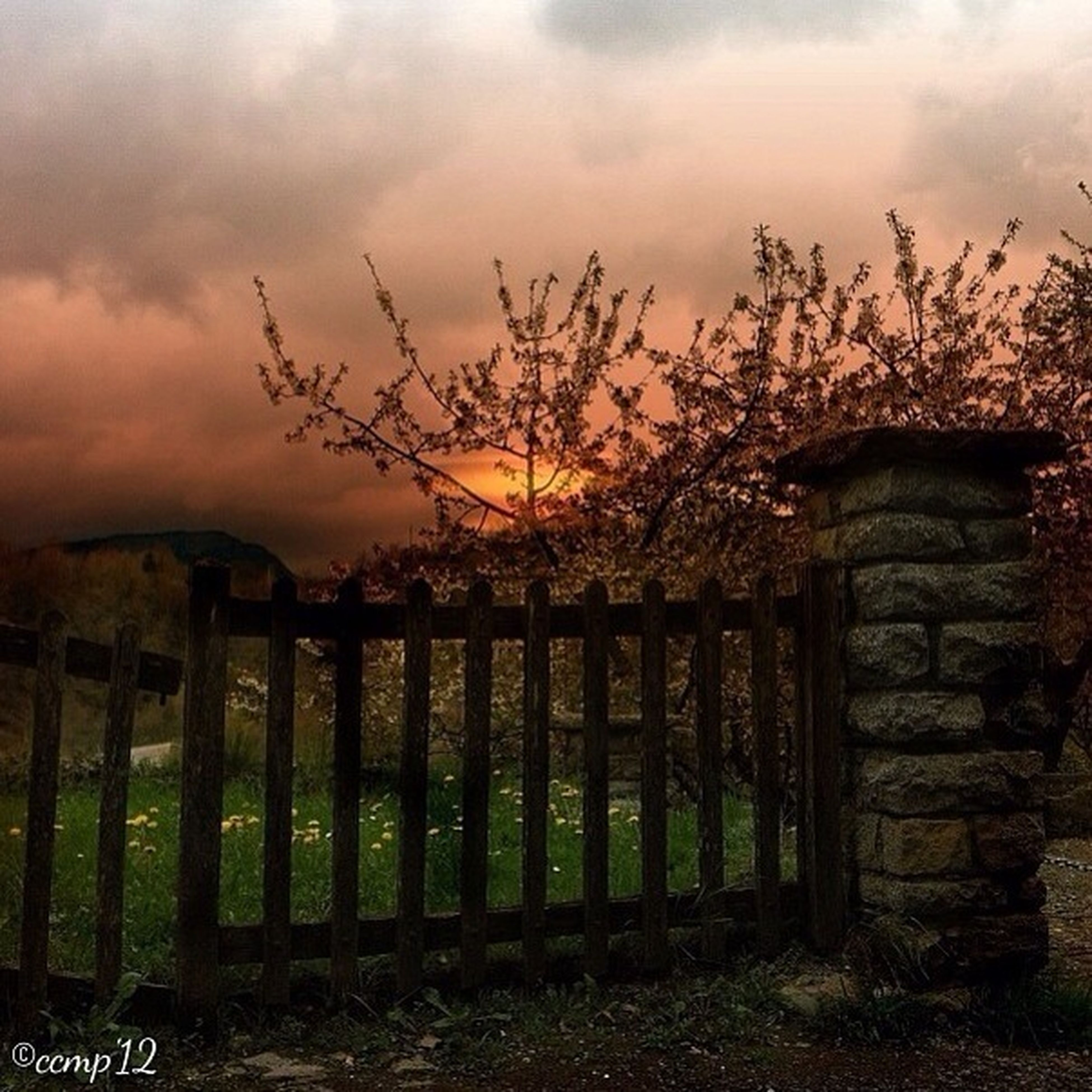 sky, cloud - sky, built structure, architecture, fence, cloudy, building exterior, cloud, old, protection, wood - material, sunset, safety, house, field, outdoors, nature, tranquility, security, abandoned