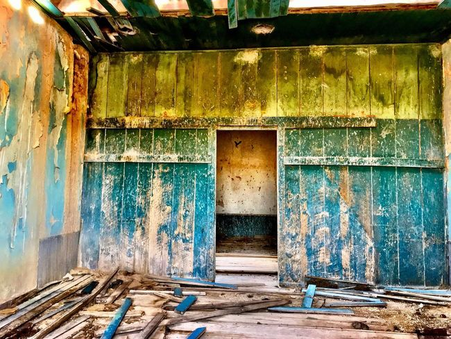 """""""Mystery Ranch No. 8"""" In through the outdoor. Old House Old Buildings New Mexico Photography New Mexico Colorful Abandoned Buildings Abandoned Abandoned Places Peeling Paint Building Interior Wood - Material Door Architecture Weathered Abandoned Damaged Run-down Doorway"""