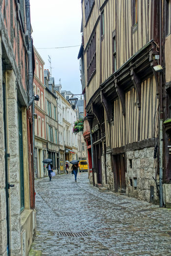 Half-Timbered houses - Rouen, France Adult Architecture Building Exterior Built Structure City Cobblestone Day Full Length Group Of People Half Timbered House History Place Joan Of Arc Lifestyles Mediievil Men Outdoors People Real People Residential Building Rouen, France Sky Street The Way Forward Walking Women Lost In The Landscape
