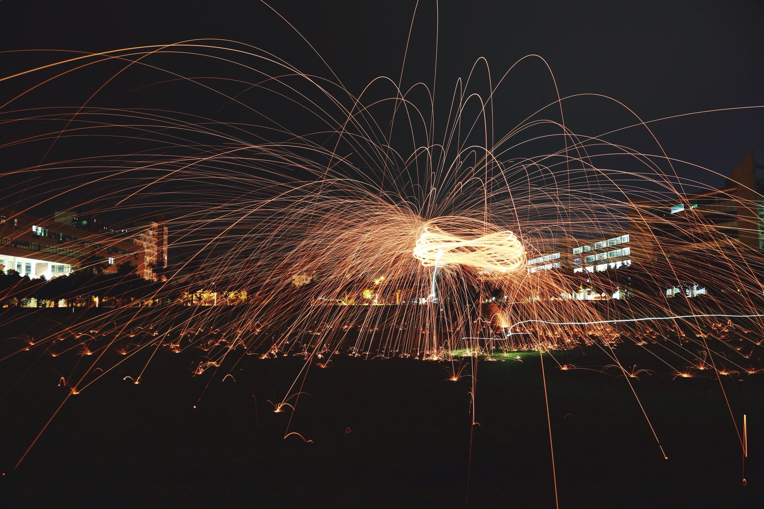 night, illuminated, long exposure, firework display, celebration, glowing, sparks, motion, firework - man made object, exploding, arts culture and entertainment, lighting equipment, event, blurred motion, firework, sky, low angle view, entertainment, light, light - natural phenomenon