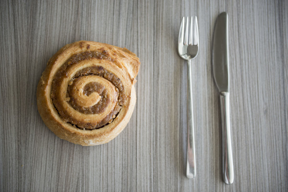 Bun on the Table with Fork and Knife Apple Pie Bread Bun Close-up Color Day Directly Above Food Food And Drink Fork Freshness High Angle View Indoors  No People Orden Ready-to-eat Simplicity Still Life Sweet Food Sweet Pie Table Tart - Dessert Wood - Material