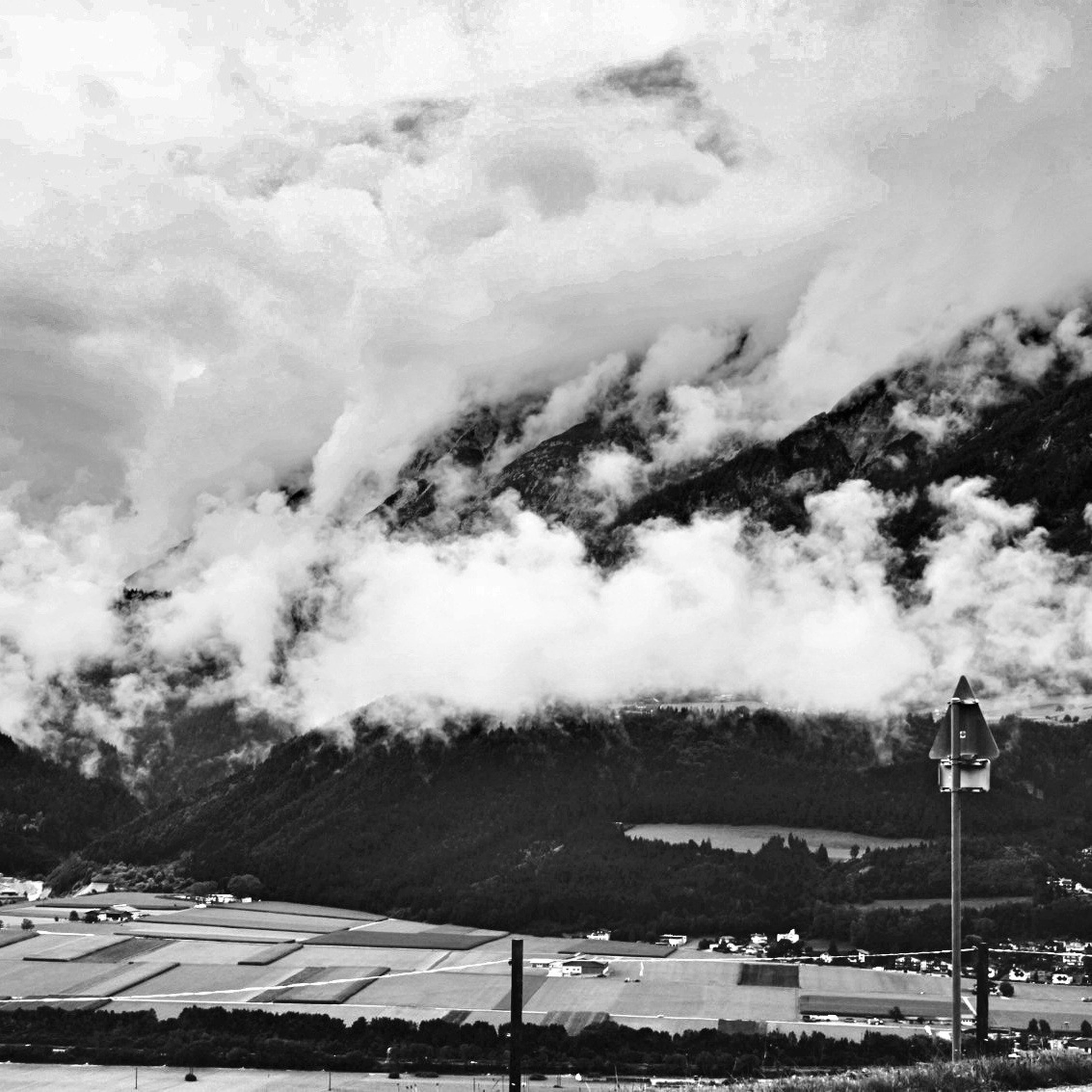 mountain, sky, mountain range, cloud - sky, scenics, weather, beauty in nature, tranquility, tranquil scene, cloudy, nature, landscape, winter, snow, cloud, non-urban scene, idyllic, cold temperature, outdoors, overcast