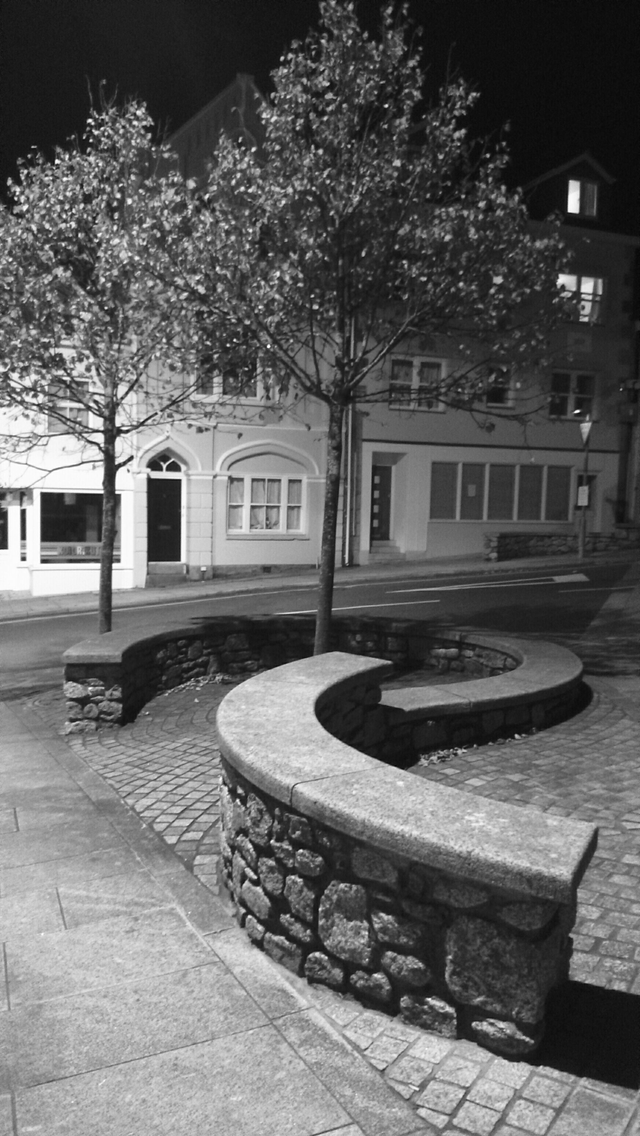 building exterior, built structure, tree, architecture, cobblestone, street, sidewalk, bench, paving stone, outdoors, bare tree, city, empty, absence, footpath, transportation, day, no people, house