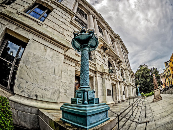 Fisheye View Supreme Court of Louisiana in the French Quarter New Orleans LA 5 Architecture Building Exterior Built Structure City Cloud - Sky Day Fisheye French Quarter Lamp Low Angle View New Orleans, LA No People Outdoors Sculpture Sky Statue Statue Supreme Court Of Louisiana Travel Destinations