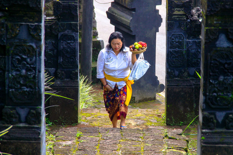 One Person Females Portrait Person Outdoors People Cultures Indonesian Culture Heritage Religious  Temples One Woman Only Indonesia Culture Rural Scene Religion And Tradition