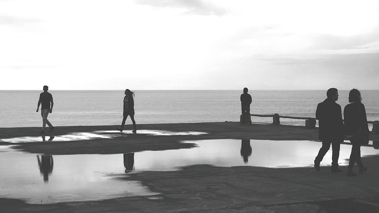 People near the Sea Walking Around Monochrome Photography Shadow Photography People Shadow Black And White Photography Reflections In The Water People Reflections Showcase: October Black And White Photographing
