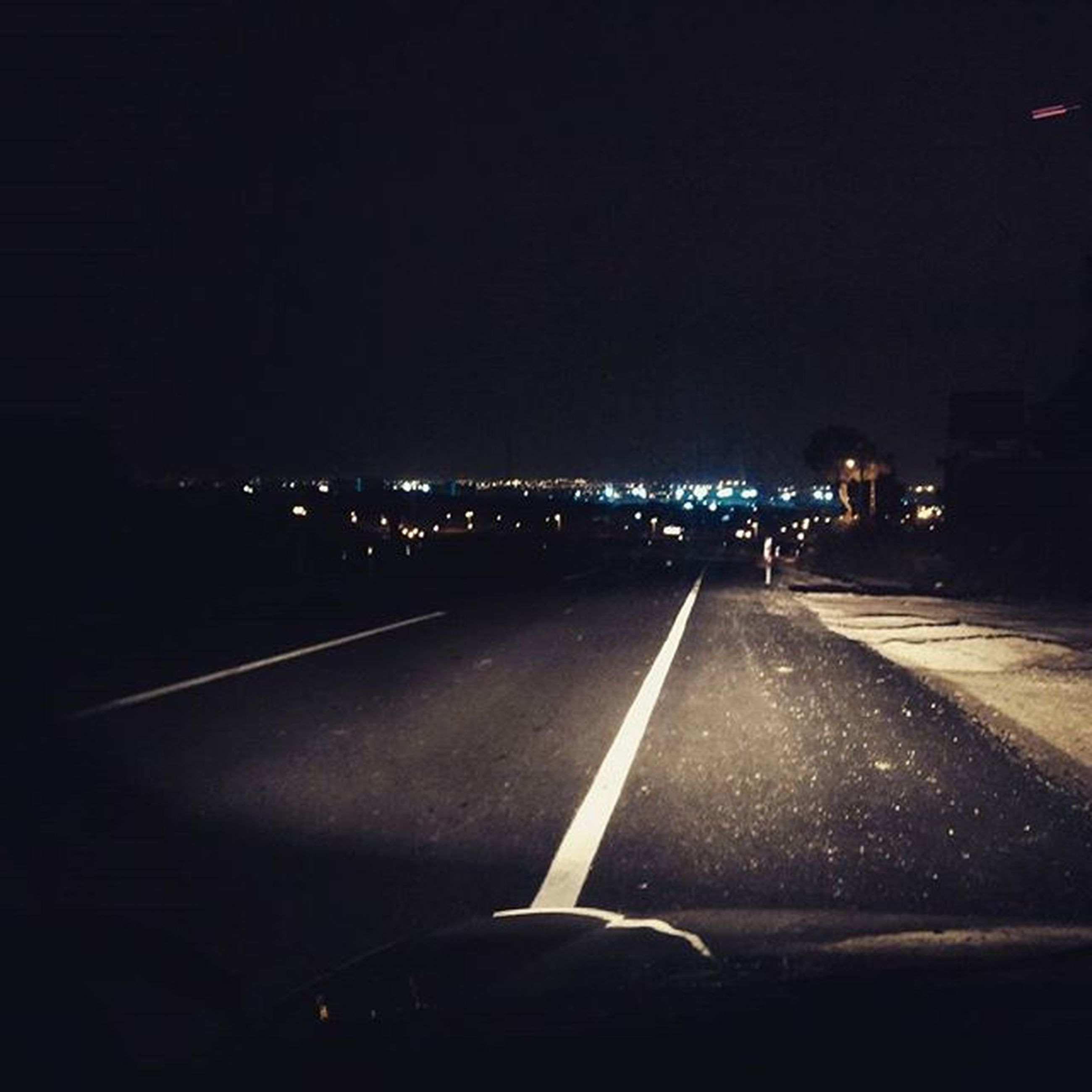 night, illuminated, transportation, road, road marking, the way forward, copy space, dark, diminishing perspective, mode of transport, lighting equipment, street, vanishing point, street light, car, empty, on the move, land vehicle, clear sky, travel