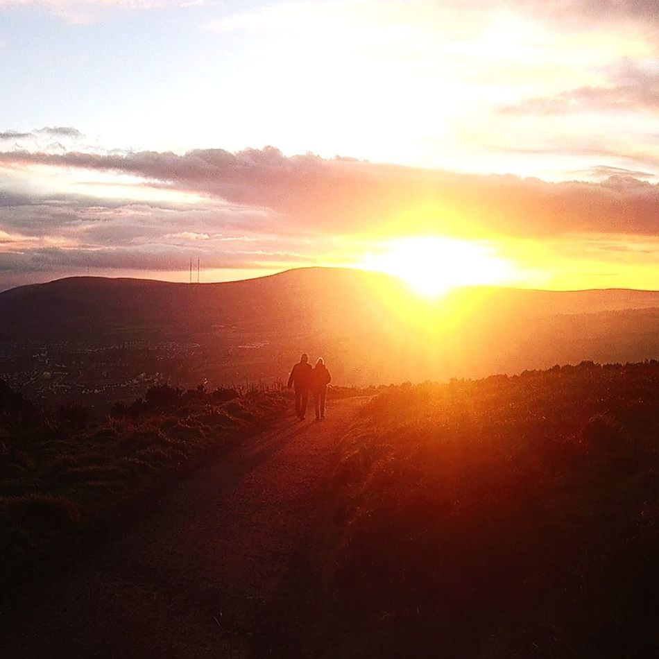 Beautfiful sunset at the Cave Hill! Sunset Sunlight Nature Full Length Environmental Conservation Sky Red Beauty In Nature Social Issues Landscape Outdoors Sun Fog Animal Themes Day No People Belfast Cavehill Northern Ireland Light And Shadow