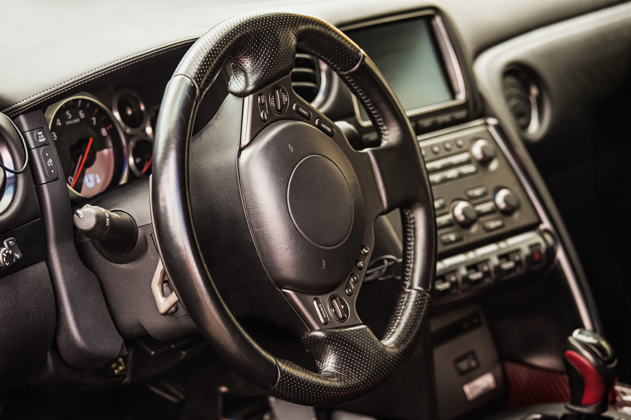 vehicle interior, car interior, dashboard, control, car, control panel, transportation, mode of transport, steering wheel, no people, technology, land vehicle, music, speedometer, gauge, close-up, radio station, day