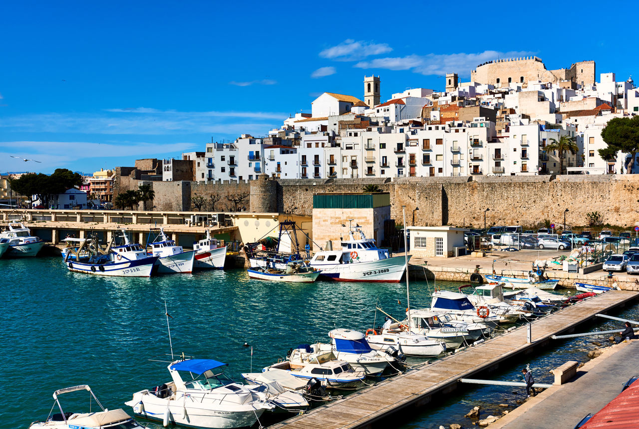 Peniscola, Spain - March 27, 2016: Harbor and old town of Peniscola. Costa del Azahar, province of Castellon, Valencian Community. Spain Ancient Architecture Architecture Bay Of Water Blue Sky Building Exterior Castellón Castle Costa Del Azahar Editorial  Fishing Boats Harbor Hillside Landmark Landscape Mediterranean Sea Nautical Vessel Old Town Outdoors Papa Luna Castle And The Church Of The Ermitana-Peñiscola Peñíscola Port Scenery SPAIN Sunny Day Travel Destinations