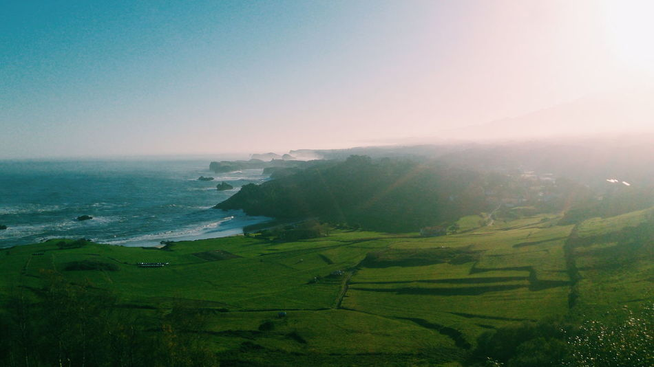 Asturian coast Beauty In Nature Blue Coastline Day Grass Green Color Growth Hill Horizon Over Land Horizon Over Water Idyllic Landscape Mountain Nature No People Non-urban Scene Outdoors Remote Scenics Sky Sun Sunbeam Tranquil Scene Tranquility Water