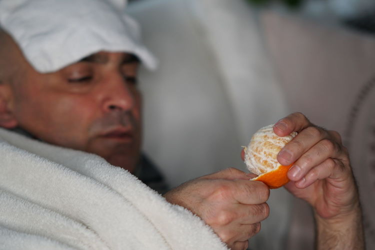 Sick men lying in bed and eating an orange Orange Vitamine C Allergy Citrus Fruit Cold And Flu Disease Fever Grippe Health Care And Medical Healthcare And Medicine Ill Illness Influenza Orange - Fruit Sick Man Sickness Temperature Vaccinated Vaccination Vaccine Vaccines Vitamin C Food Stories