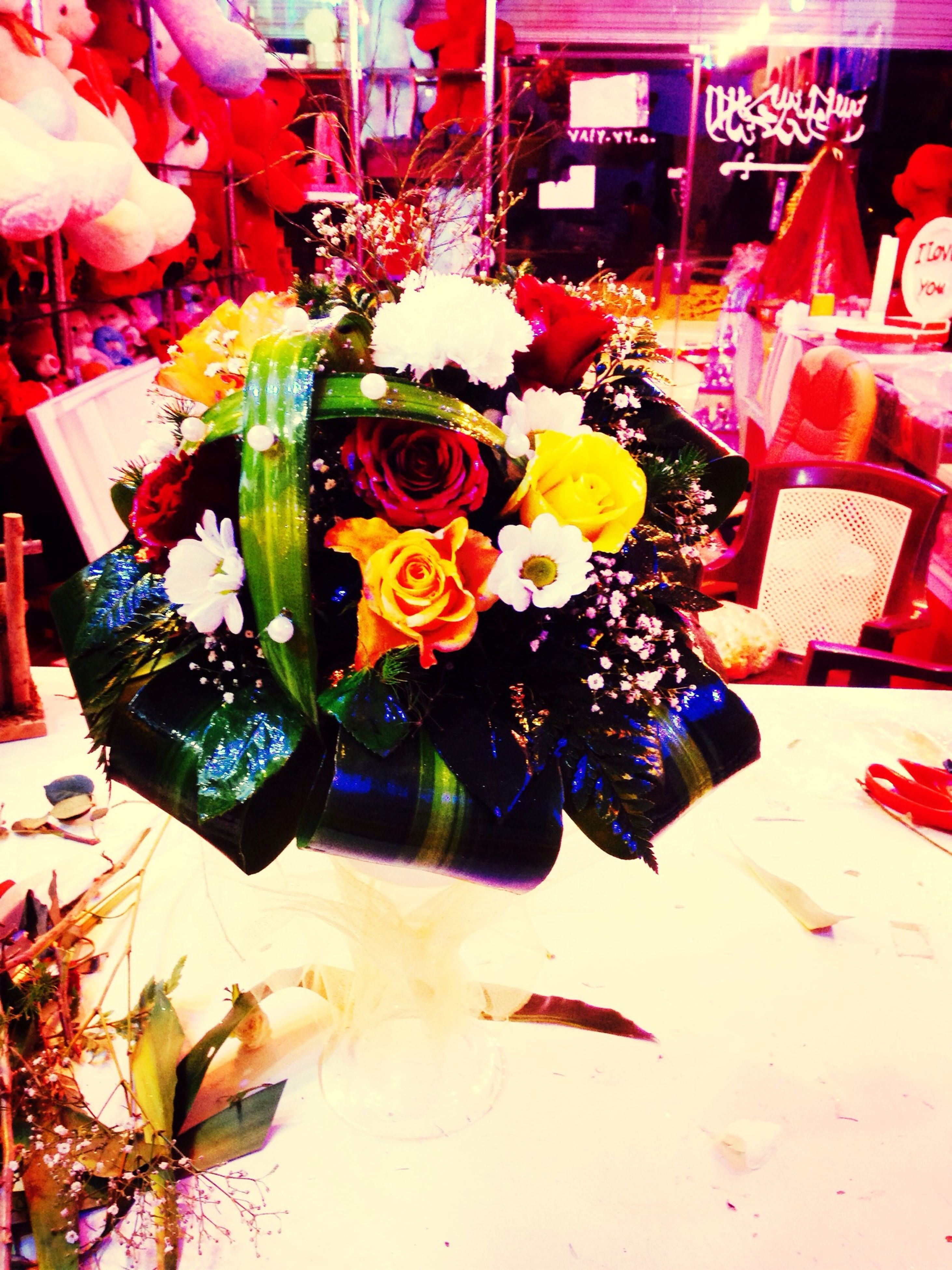 indoors, decoration, flower, table, multi colored, variation, vase, art and craft, still life, no people, creativity, arrangement, home interior, art, potted plant, celebration, house, built structure, bouquet, hanging