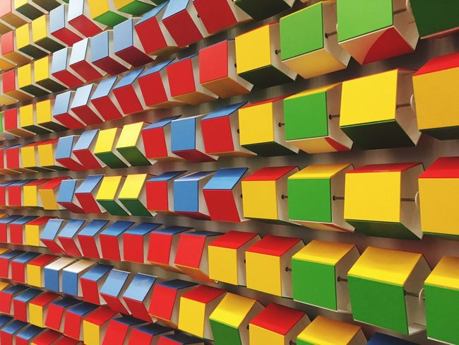 Multi Colored Vibrant Color Vertical Pattern Large Group Of Objects Backgrounds Variation Full Frame No People Close-up Day Fanned Out Cubes Wall Decor Madebygoogle Popupshop Google NYC New York City