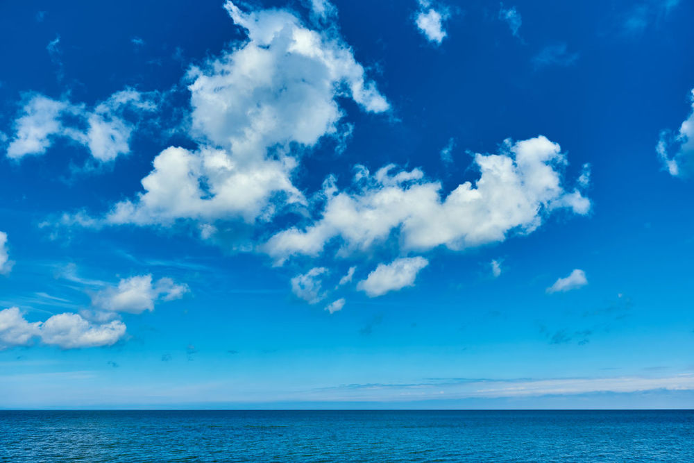 Bright cloudy sky and horizon over the Baltic Sea Air Baltic Sea Beauty In Nature Blue Sky Bright Colors Cloudy Fluffy Clouds Heavens Horizon Over Water Idyllic Landscape Nature Nature Background No People Northern Europe Scenery Sea Serenity Smooth Summer Summertime Sunlight Sunny Day Sunshine View