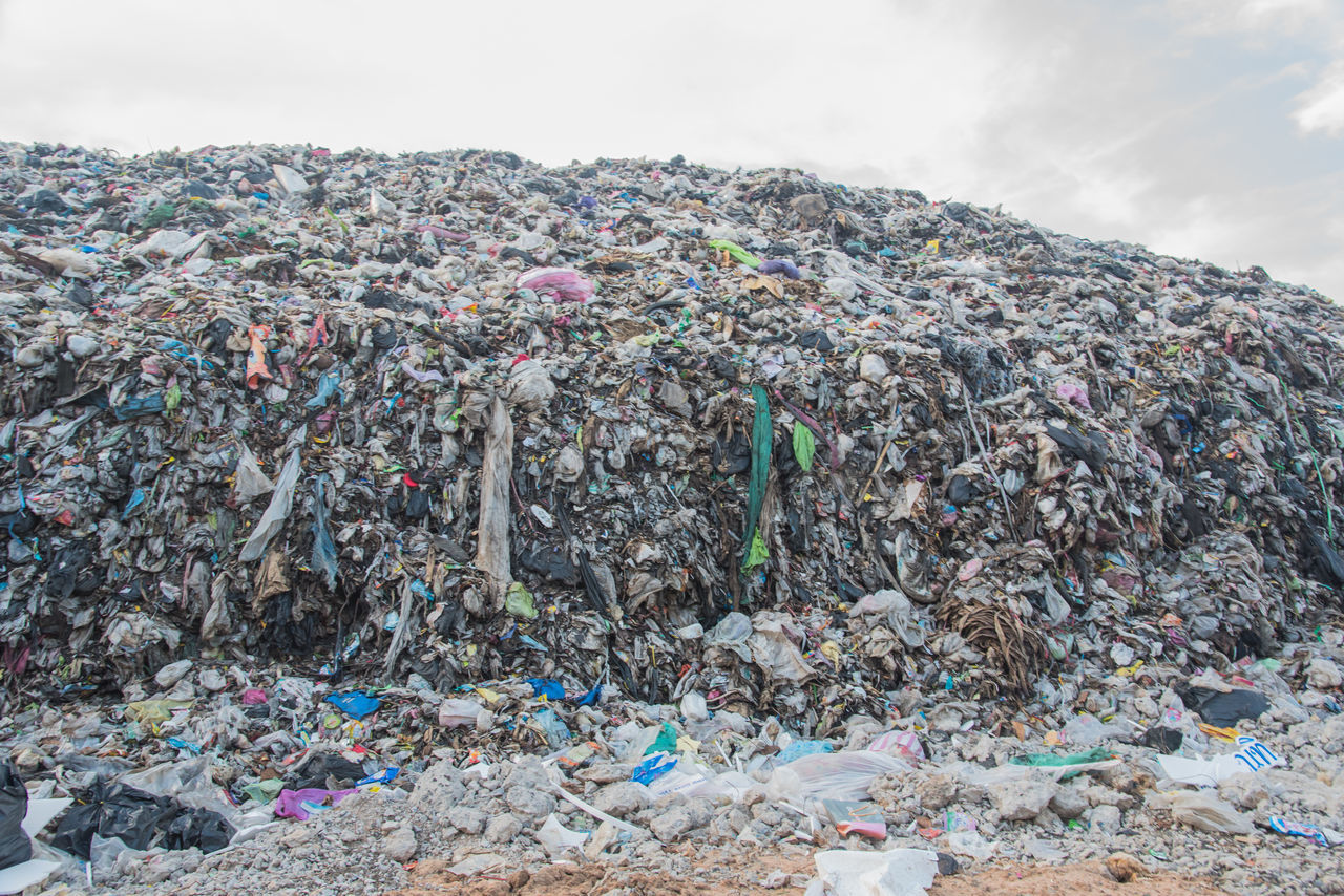 garbage, waste management, stack, environmental issues, sky, abundance, large group of objects, recycling center, day, heap, outdoors, bubble gum, no people, multi colored