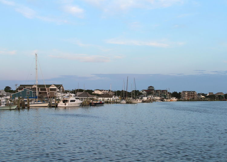 Architecture Bay Beauty In Nature Boats Building Exterior Cloud - Sky Day Harbor Moored Nature No People Ocracoke Island Outdoors Outer Banks, NC Sailboat Sailing Ship Sea Sky Water Yacht