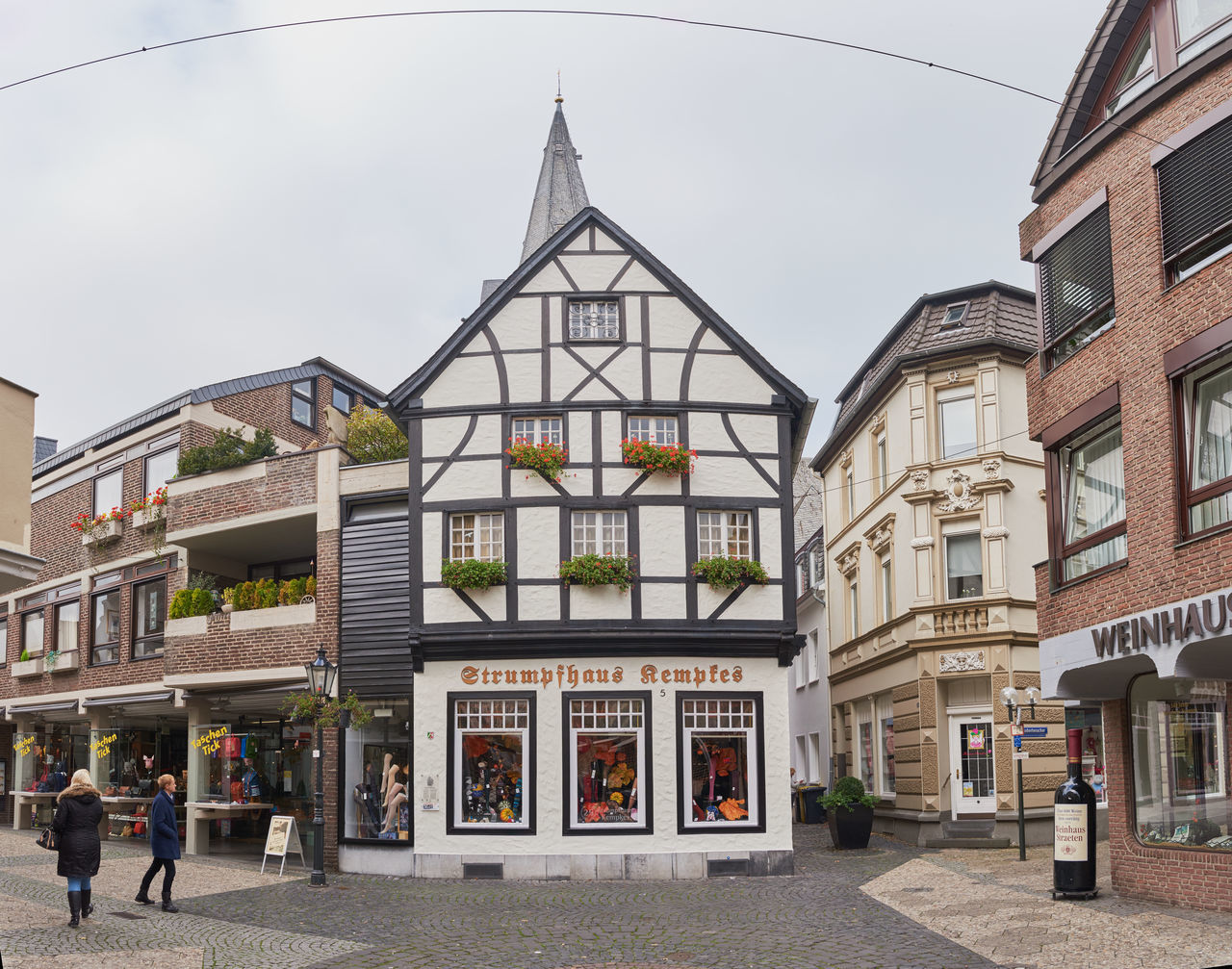 KEMPEN, GERMANY - OCTOBER 26, 2016: Traditional retail stores can be found in the old town. Atmospheric Mood Christanity Colorful Downtown Germany Heritage High Resolution Historic City History Light Love Market Medieval Outdoors People Relaxing Shopping Travel Destination Urban