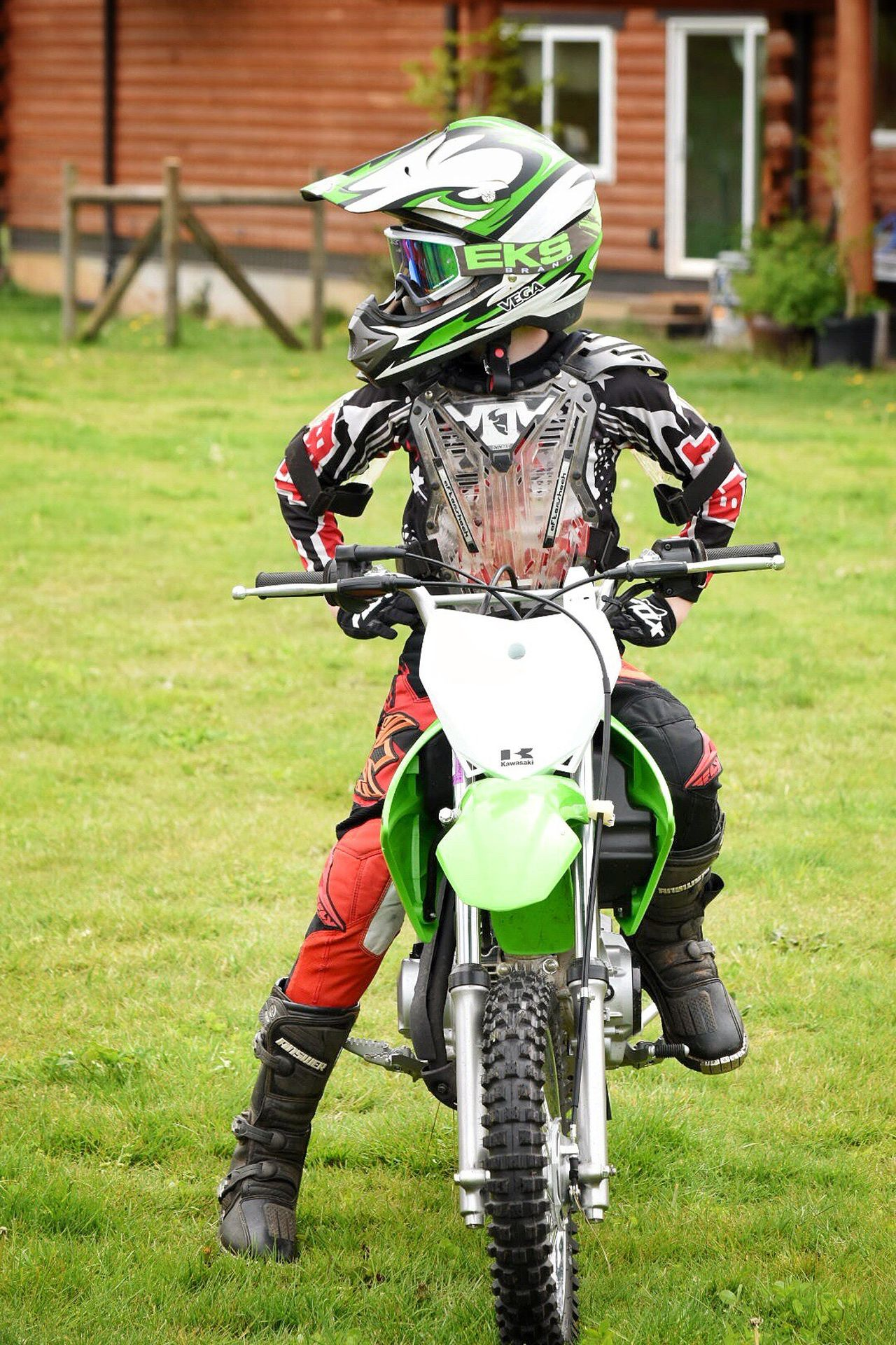 Grass Motorcycle Outdoors Green Color Headwear Day Stationary No People Sport Protective Workwear Close-up The Great Outdoors - 2017 EyeEm Awards Childhood Memories Youth Of Today Dirtbike Youth Culture Sports Helmet Motocross Crash Helmet Lifestyles Motorcycle Riding Motorsport Extreme Sports Real People