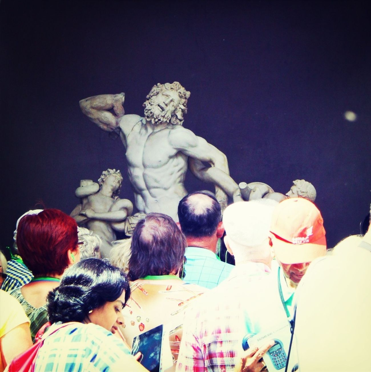 The statue Laocoon and his sons is always surrounded by visitors. Statue Museum Vatican