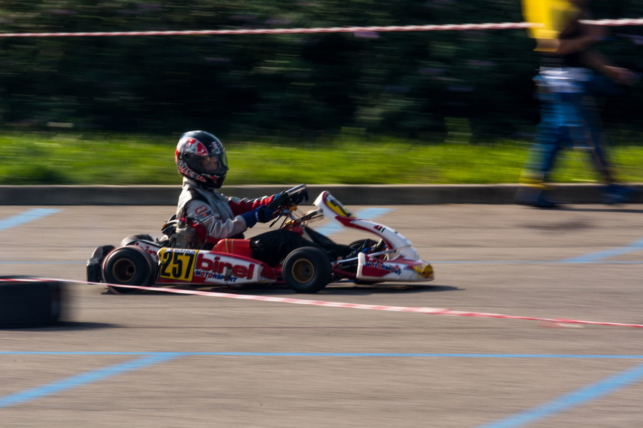 kart panning Audience Auto Racing Competition Competitive Sport Crash Helmet Day Driving Headwear Motion Motor Racing Track Motorcycle Racing Motorsport People Professional Sport Racecar Safety Speed Sport Sports Race Two People