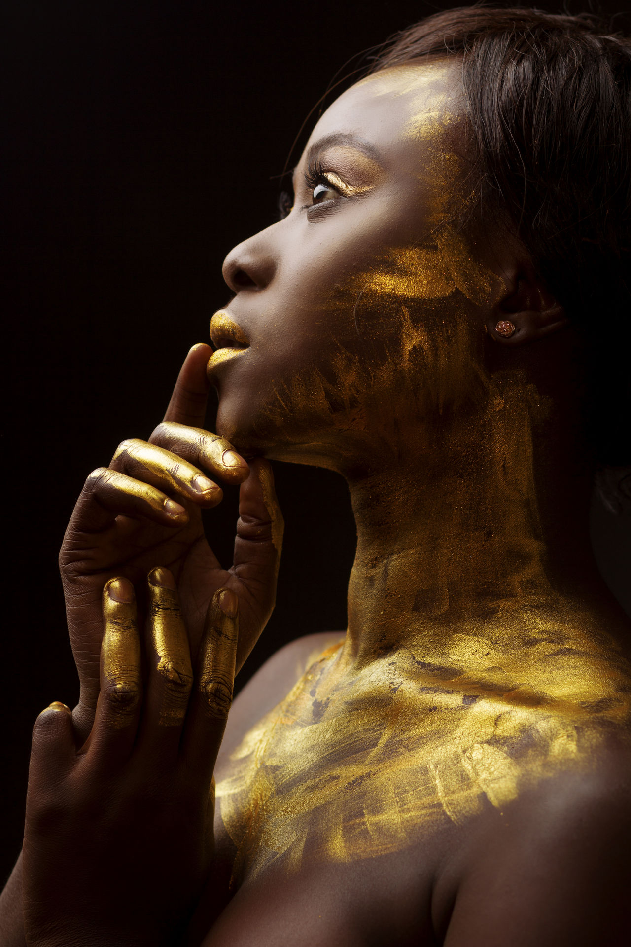 Black Background Close-up Editorial  Editorial Fashion Editorial Photography Formal Portrait Gold Gold Gold Colored Headshot Human Body Part Human Hand Lines Religion Shadow Shadows & Lights Spirituality Studio Photography Studio Shot Touching