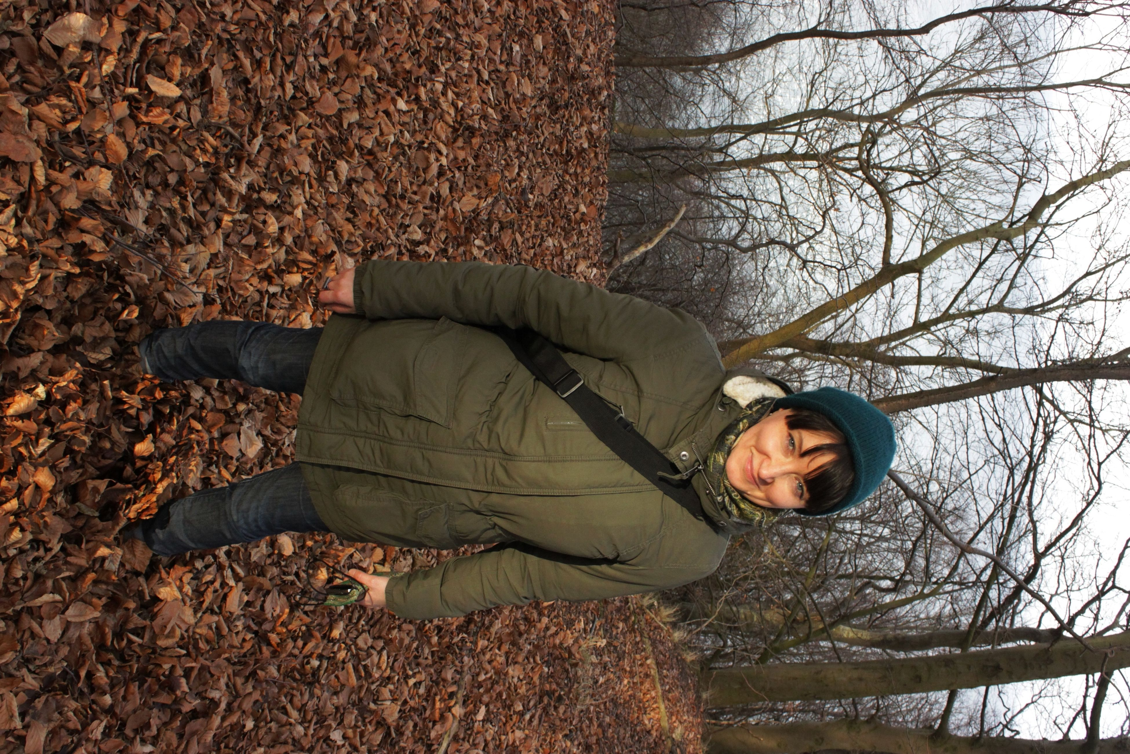 looking at camera, lifestyles, portrait, casual clothing, young adult, tree, front view, standing, leisure activity, person, full length, forest, warm clothing, young women, season, bare tree, autumn, jacket
